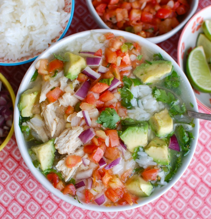 Forget the soup at the restaurant and make your own Slow Cooker Mexican Chicken Lime Soup. This soup is sweet, spicy and is filled with shredded chicken, corn, avocado, rice and your favorite soup toppings.