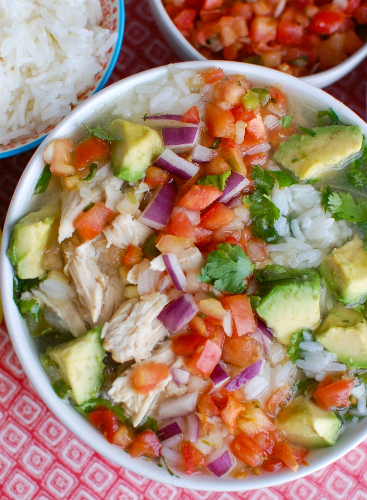 Forget the soup at the restaurant and make your own Slow Cooker Mexican Chicken Lime Soup. This soup is tart, sweet, spicy and is filled with shredded chicken, corn, avocado, rice and your favorite soup toppings.