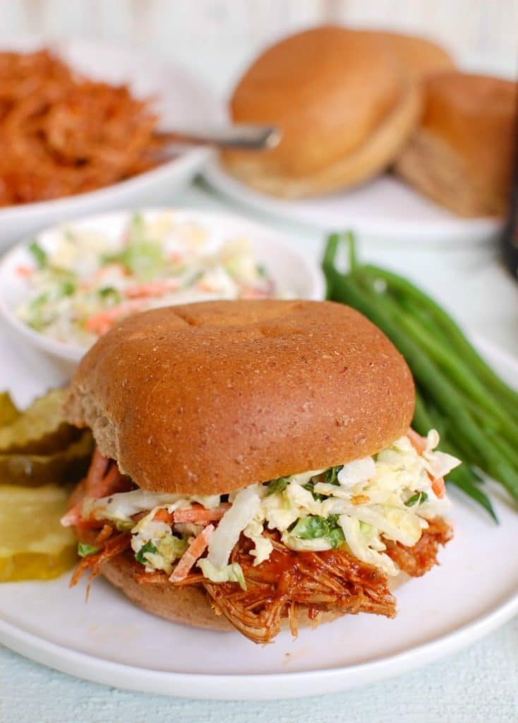 BarbecuePulled Pork is a pork shoulder crock pot recipe, made with a flavorful BBQ sauce. This slow cooker pulled pork recipe makes the perfect sandwich or even a filling for quesadillas!
