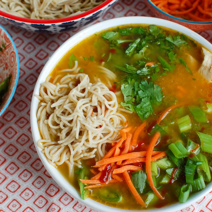 Asian Chicken Noodle Soup in a white bowl