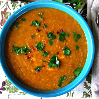 Moroccan Red Lentil Soup is a comforting soup recipe.  The warm, rich spices of cinnamon, coriander, cumin, paprika and tumeric mix together perfectly to create a flavorful soup.