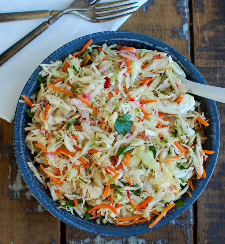 Healthy Coleslaw {Mom's Kitchen} is a light and healthy coleslaw mixing cabbage, carrots and radishes and tossed in a light dressing and fresh herbs. This is perfect as a side salad or a topping to sandwiches.