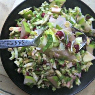 Shaved Brussels Sprout Salad With Apple and Pomegranate recipe from A Cedar Spoon