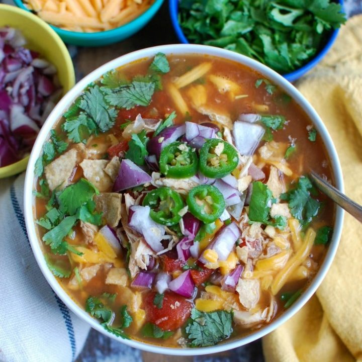 Slow Cooker Chicken Tortilla Soup with spoon