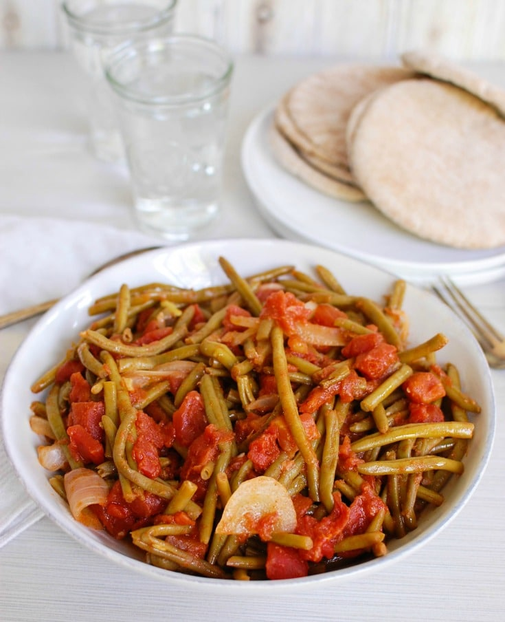 Lebanese Green Beans , or Lubee, are slow simmered green beans. These make the perfect side dish to any weeknight meal.
