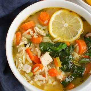 Lemon Chicken Orzo Soup in white bowl