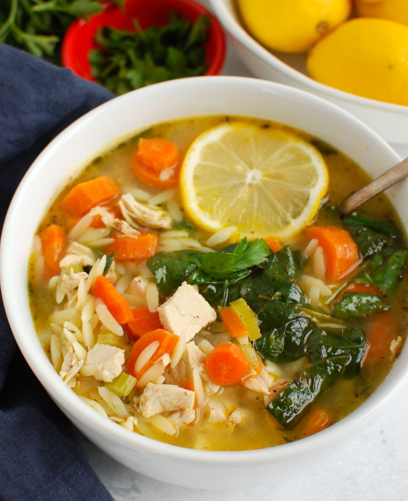 Lemon Chicken Orzo Soup with a spoon