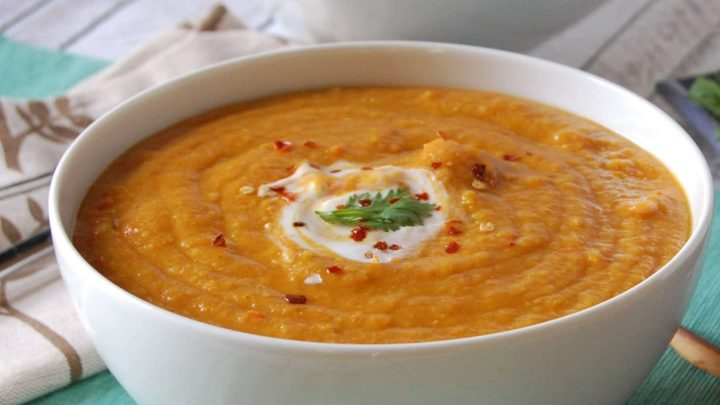 Moroccan Carrot Red Lentil Soup is a meatless soup recipe packed full of flavor! Cumin, turmeric, coriander, paprika and cinnamon compliment the red lentils and carrots, creating a creamy, filling soup.