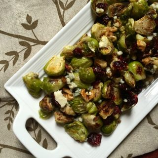 Brussels Sprouts with Cranberries on white platter