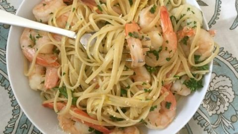 15 Minute Shrimp Linguine With Lemon Garlic Butter Sauce is a light pasta dish mixing shrimp, fresh parsley and a lemon garlic butter sauce. This seafood pasta recipe is a great for a romantic date night, a dinner party or a light weeknight meal. Pair with a good bottle of white wine, crusty bread and a salad.
