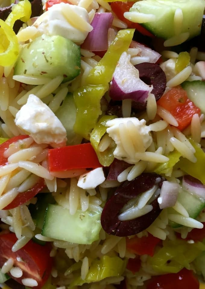 Greek Orzo Pasta Salad with crisp vegetables, olives, pepperoncini, and feta cheese