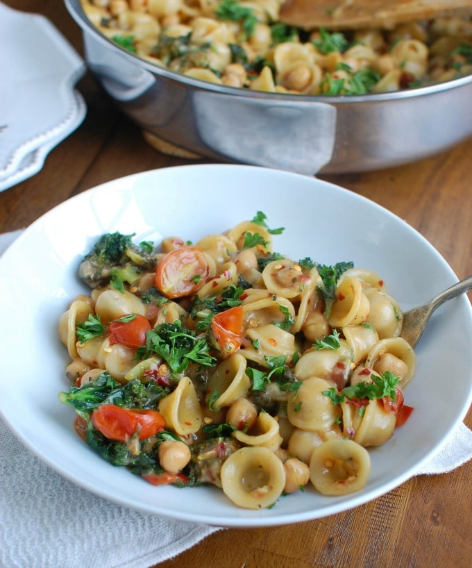 One Pot Kale Broccoli Chickpea Orecchiette Pasta in white dish