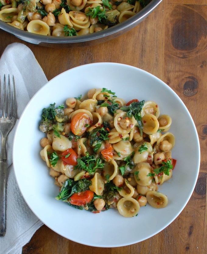 One Pot Chickpea Kale Pasta Recipe with white bowl and napkin.