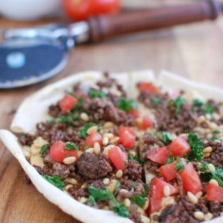 Spiced Beef and Hummus Pita Pizza on cutting board