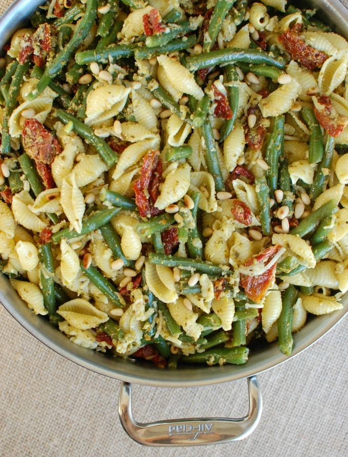 Pesto Pasta with Green Beans Sun-dried Tomatoes and Toasted Pine Nuts in pan.