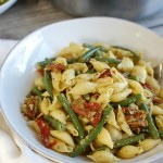 Pesto Pasta with Green Beans Sun-dried Tomatoes and Toasted Pine Nuts