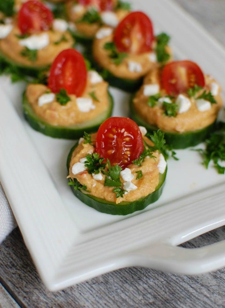 Cucumber Hummus Bites on white plate