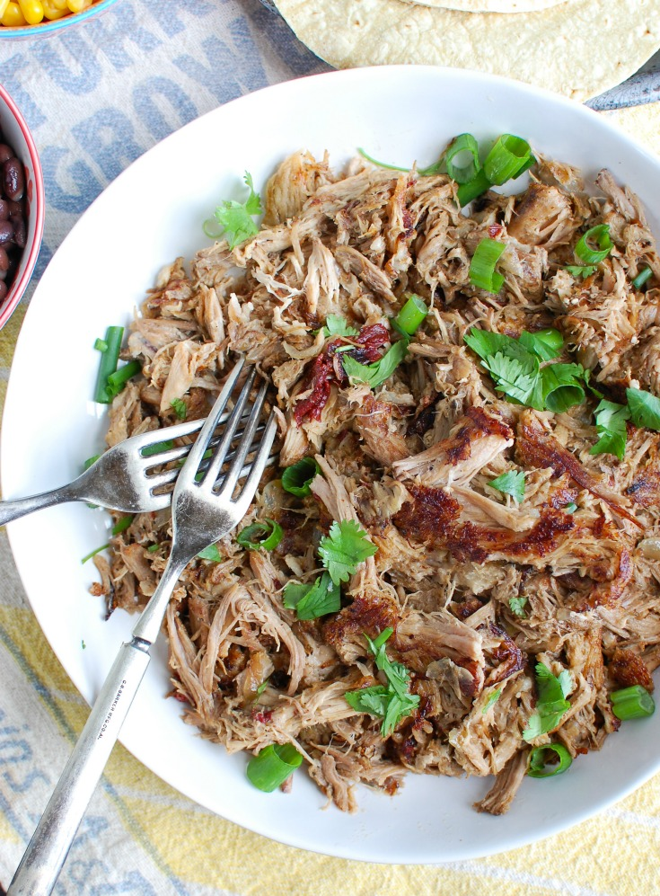 Easy Slow Cooker Pork Carnitas In a White Bowl