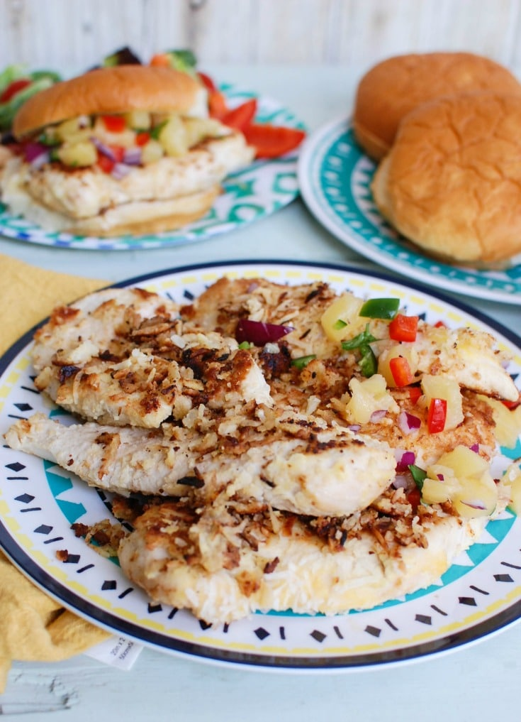 Macadamia Coconut Crusted Chicken with Pineapple Salsa make the perfect fresh, summer meal. Tropical flavors pair nicely with the chicken!