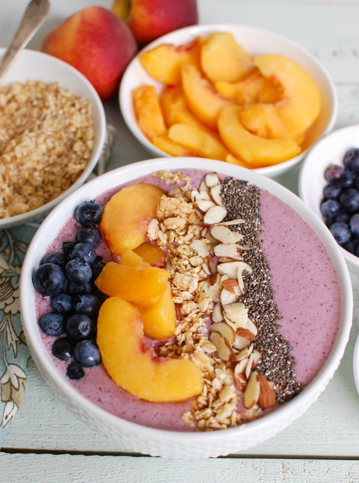 Peach Blueberry Smoothie Bowl is the perfect start to your day. Healthy ingredients make this a good choice for a snack too.