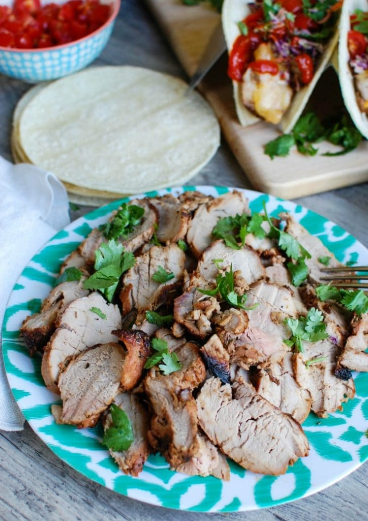 Asian Pork Tacos with Spicy Slaw are tender, flavorful tacos. These are so easy to make in the summer!