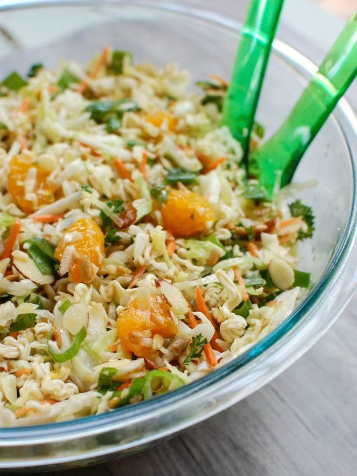 Asian Ramen Noodle Salad is ready in under 15 minutes. This is great for summer BBQs.