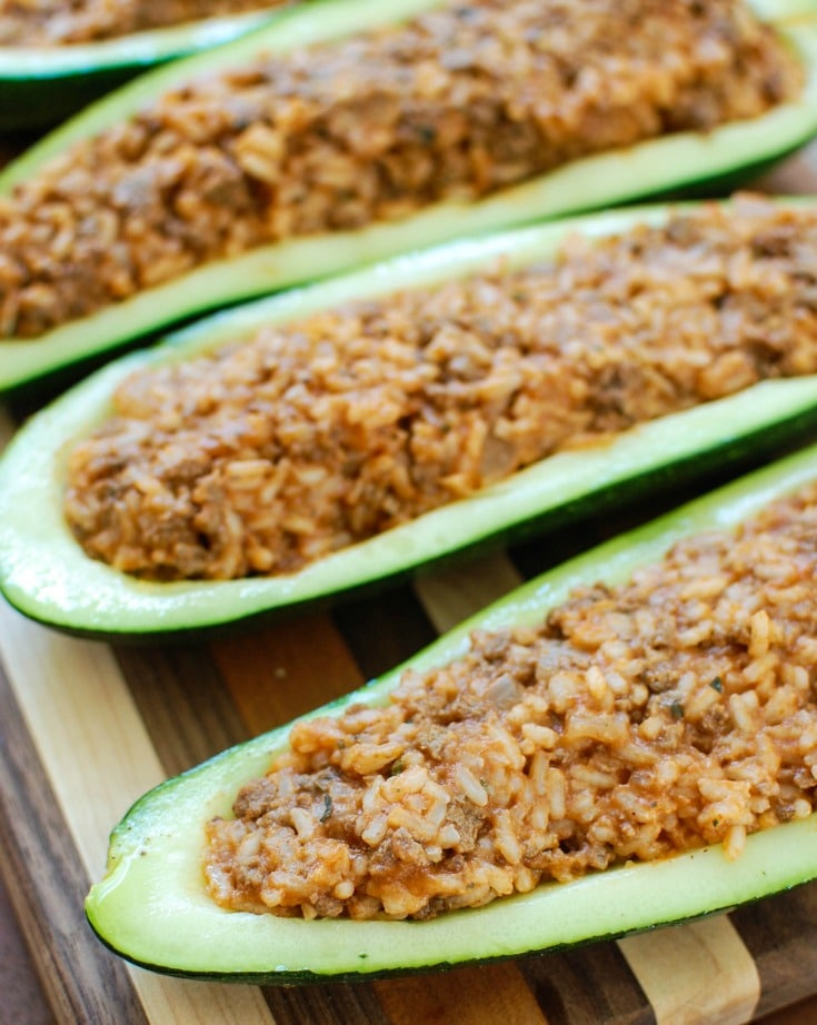 Mediterranean Zucchini Boats take summer zucchini and stuff them with a mixture of ground beef and lamb, rice, tomato sauce, cumin, cinnamon and are topped with cheese and fresh parsley. If you have an abundance of garden zucchini this is the perfect way to use them up!