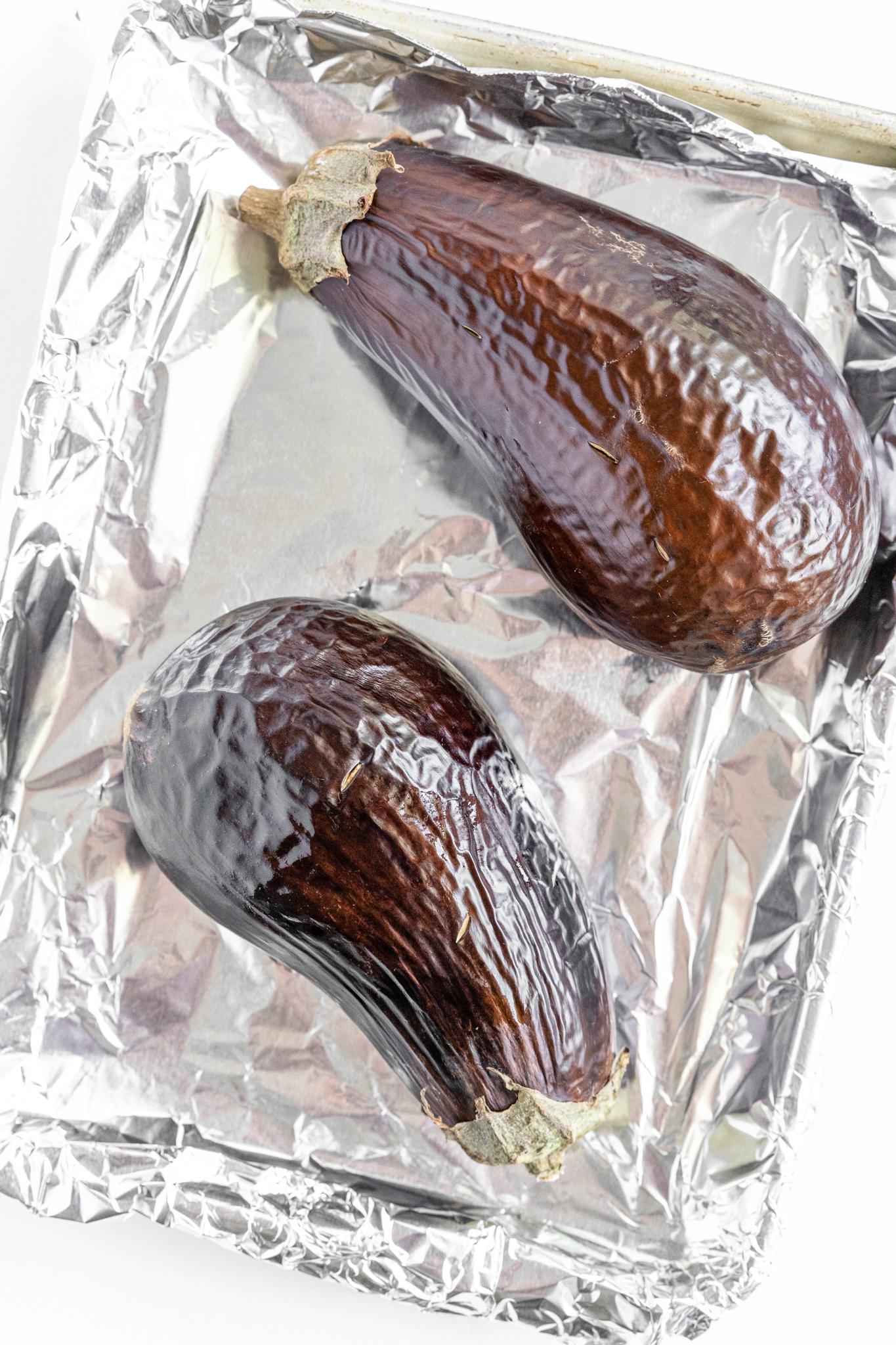 Baba Ghanoush roasted eggplant on a baking sheet.
