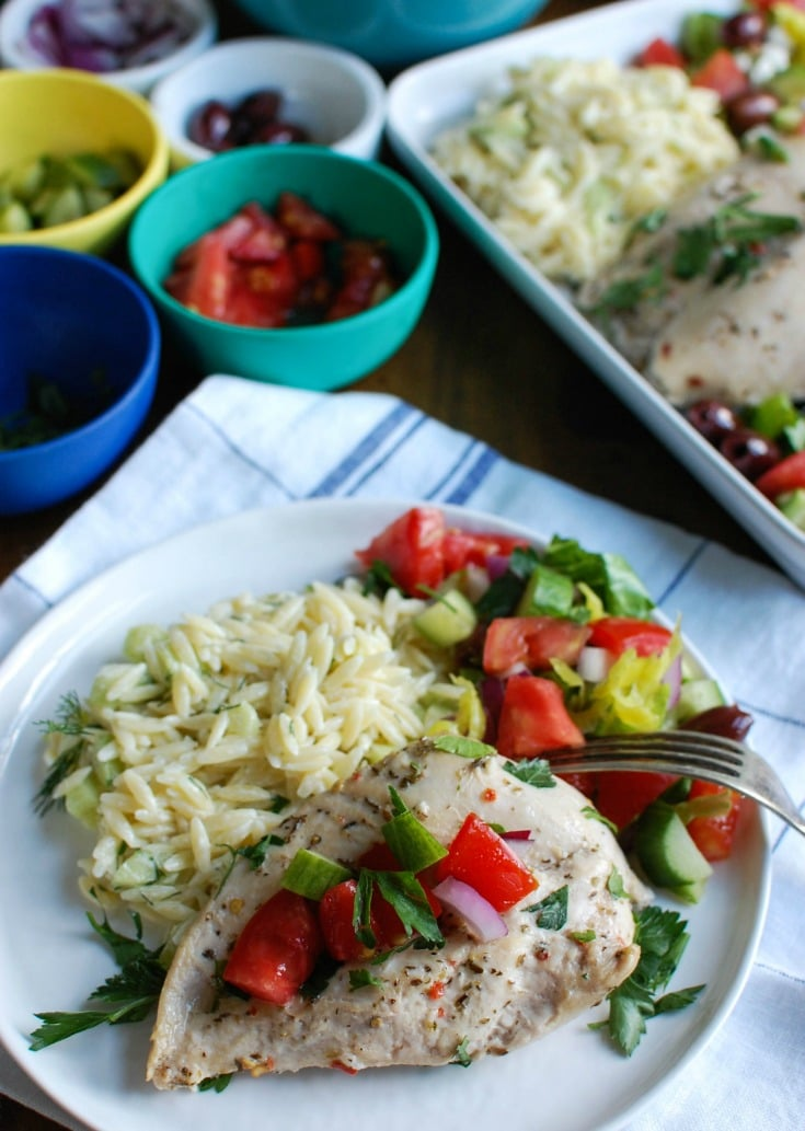 Greek Chicken with Tzatziki Orzo Salad with fork.
