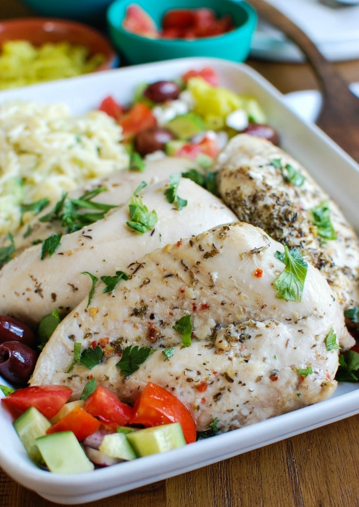 Greek Chicken with Tzatziki Orzo Salad with olives.