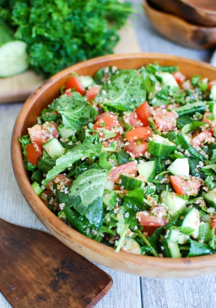 Kale Cucumber Tabbouleh with wooden spoon