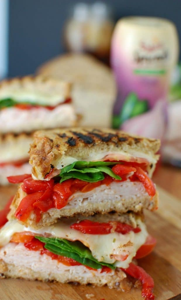 Mediterranean Turkey Hummus Panini makes a great lunch packing your favorite Mediterranean flavors into a warm, flavorful sandwich. Garlic and Herb hummus is spread on your favorite bread and topped with smoked turkey, roasted red peppers, spinach, sliced tomatoes, artichokes and havarti cheese to create the ultimate sandwich.