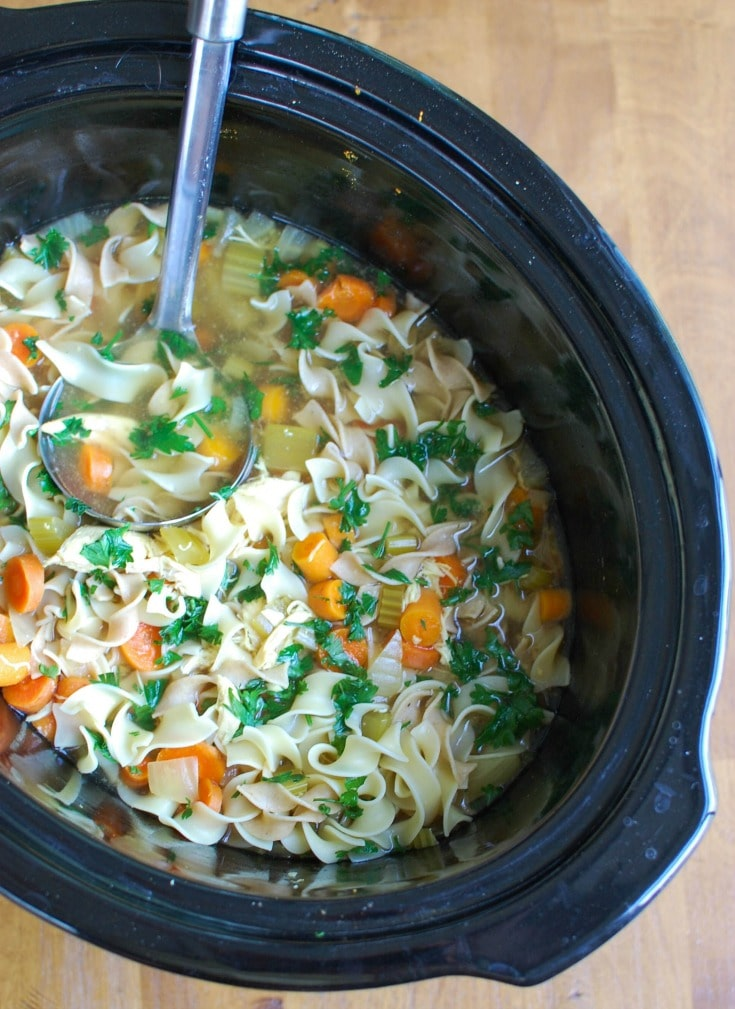 Slow Cooker Chicken Noodle Soup is the perfect fall comfort food that is easily made in the slow cooker. This is also a great immunity boosting soup for cold & flu season!