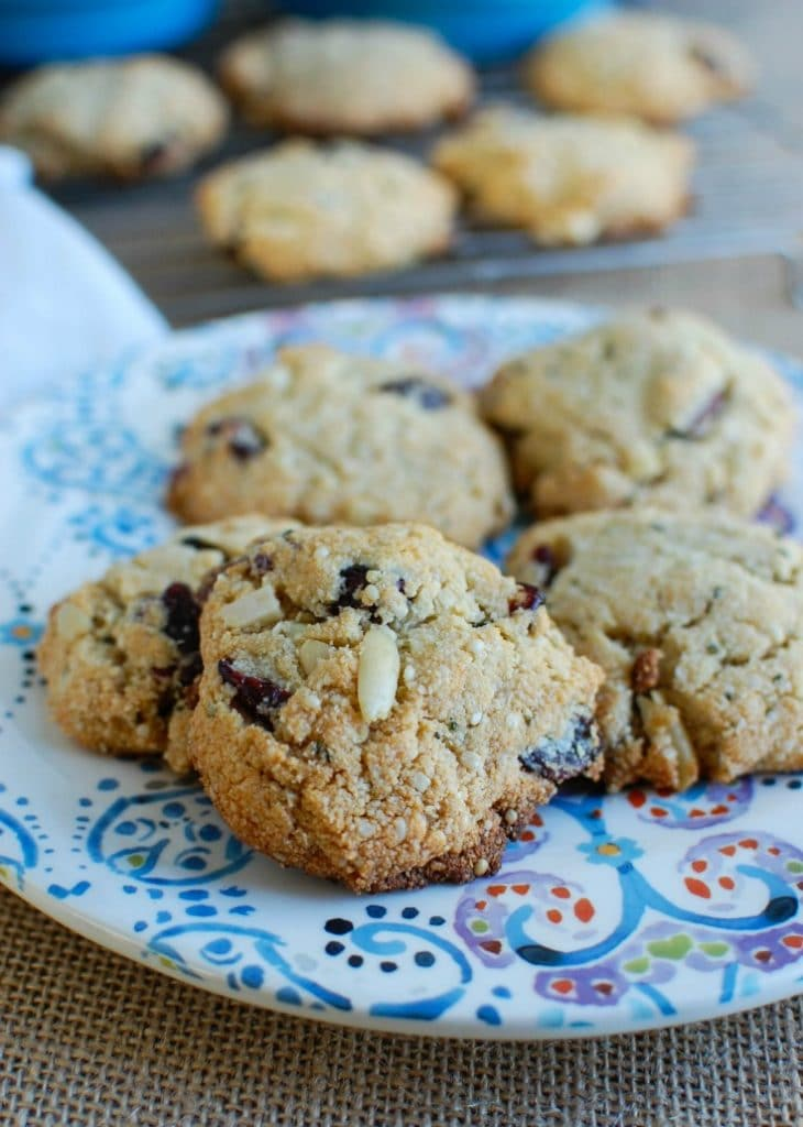 Coconut Cranberry Almond Cookies make an easy and healthy snack, treat or cookie at the holidays. These cookies are dairy and gluten free using almond flour, coconut oil and honey along with dried cranberries and silvered almonds.