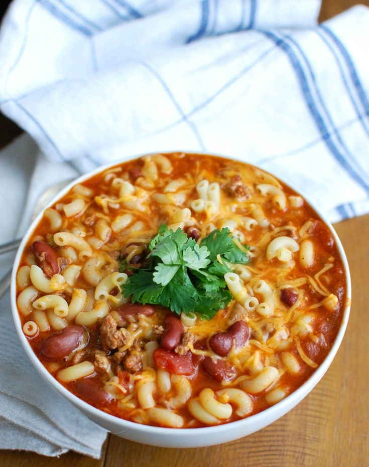 Crock-Pot® Turkey Chili Mac and Cheese is the ultimate cold weather comfort food, perfect for dinner or game day. Turkey Chili is slowly simmers in a Crock-Pot® and then pasta and cheese are mixed in when it is ready to eat. This is a family favorite!