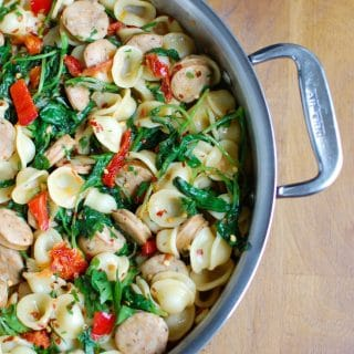 Orecchiette with Sausage Kale and Sundried Tomato is a 20 minute pasta dish that brings unique flavors together to create a mouthwatering dish. Orecchiette pasta is paired with chicken sausage, kale, sundried tomatoes and finished off in a light olive oil and lemon sauce.