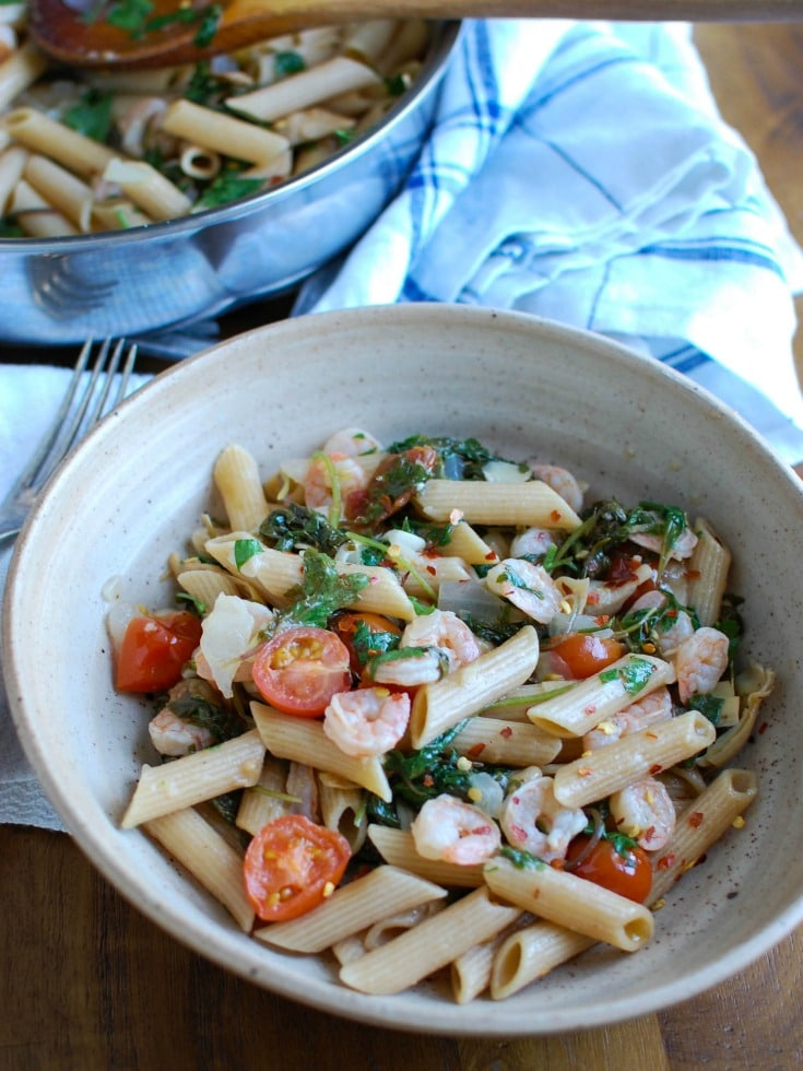 Shrimp Kale Artichoke Pasta is light, healthy and an easy meal idea. Shrimp, kale, artichokes, tomatoes and pasta and tossed in a light lemon sauce that will leave your family asking for seconds!
