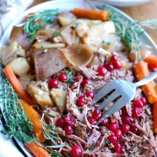 Slow Cooker Red Wine Pot Roast With Orange Cranberry Sauce is the perfect winter comfort food. This pot roast is flavorful and would make a nice holiday meal. The orange cranberry sauce adds a nice touch of sweetness to the roast and a pop of color to your table.