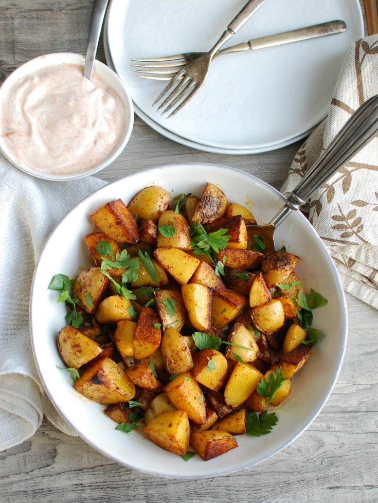 Your favorite potatoes are tossed in olive oil and smoked paprika and roasted until they are soft on the inside and crispy on the outside paired with a creamy yogurt dipping sauce. These Paprika Roasted Potatoes with Spiced Yogurt Sauce make the perfect side dish to any meal.