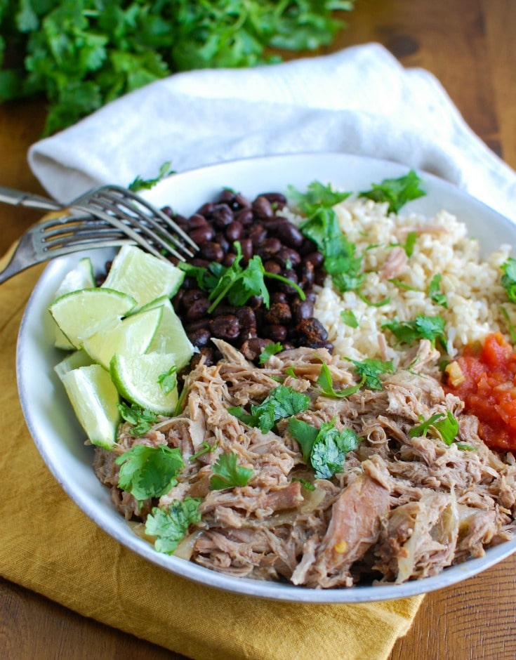 Slow Cooker Cuban Pork Rice Bowls make a healthy lunch or dinner that are easily customizable to your tastes. Cook the pork in the slow cooker with orange juice, lime and garlic along with rich spices to create a juicy, flavorful pulled pork. Pair the pork with rice and throw on your favorite toppings for an easy on-the-go lunch!