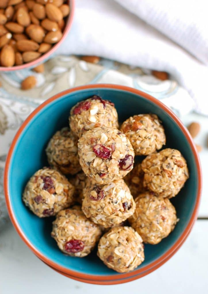 Cranberry Almond Energy Bites are a no-bake energy bite that are easy to make and even easier to throw in your bag for a quick, healthy snack or treat. Oats, chopped almonds, dried cranberries, almond butter, honey, chia seeds and cinnamon are mixed together to create a sweet, delicious bite.