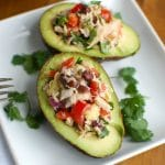 Mexican Tuna Stuffed Avocados mixes tuna, black beans, fresh vegetables, lime juice and spices to create a healthy and easy snack or lunch that is also heart healthy.