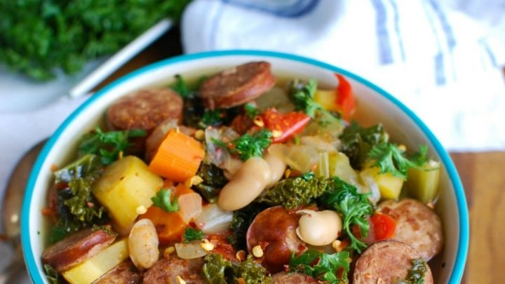 Slow Cooker Sausage Kale White Bean Soup is hearty and packed with protein and vitamins. This soup simmers in your slow cooker while you go about your day, leaving you with the perfect dinner for your family.
