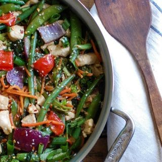 This Orange Chicken Vegetable Stir Fry is healthy, packed with a rainbow of vegetables and a light, sweet orange sauce. Forget take-out and make this version at home allowing you to customize it to your tastes!