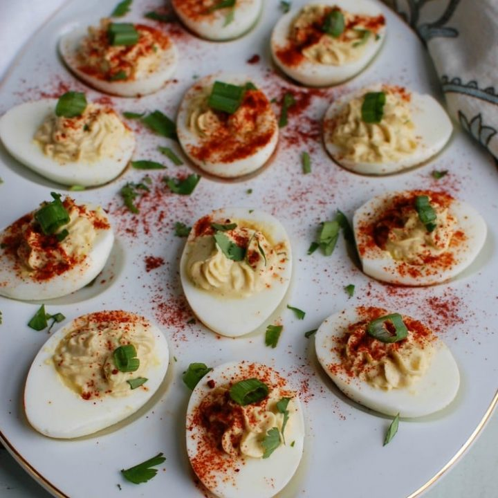 Southwestern Greek Yogurt Deviled Eggs are a healthy take on classic deviled eggs with a Southwestern twist. These deviled eggs use plain whole milk Greek yogurt in place of traditional mayonnaise for a healthy swap. Deviled eggs make a nice appetizer or finger food at a party, but also a great dish to bring to a summer pot-luck.