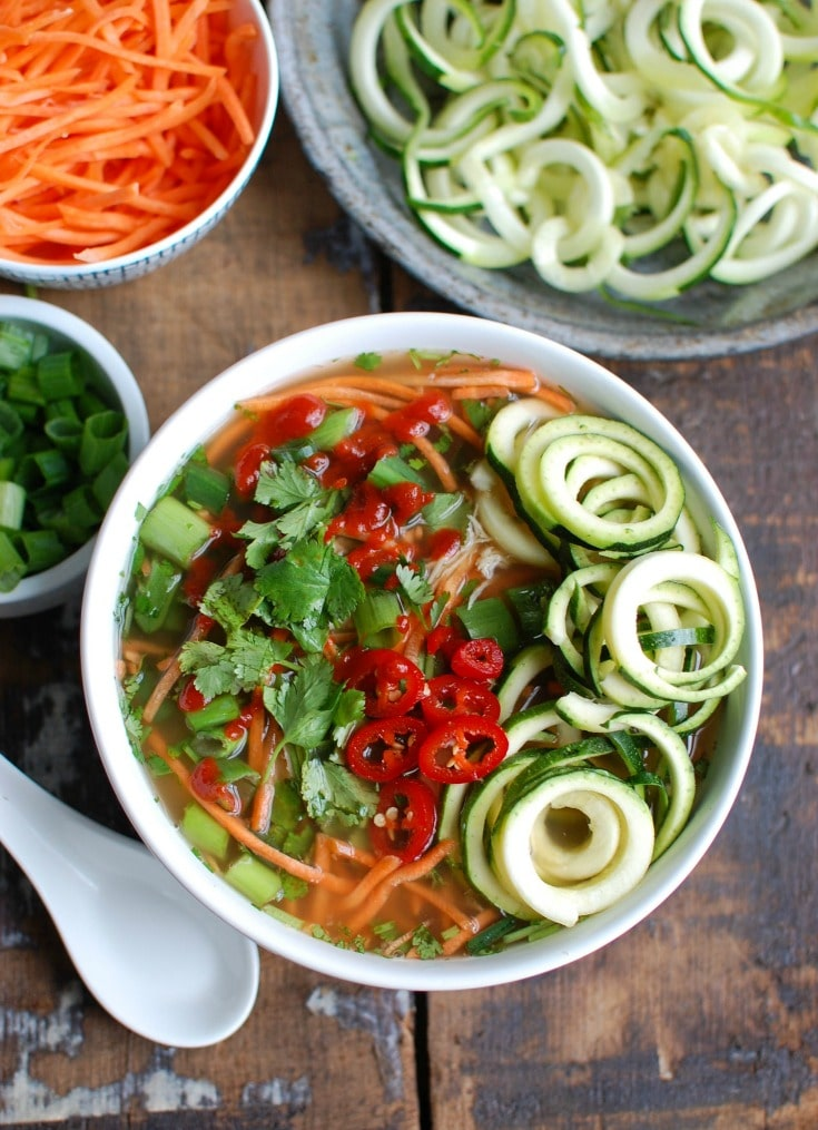 Spicy Asian Chicken Zoodle Soup is a lightened up version of your favorite Asian Chicken Noodle Soup using zucchini noodles. A spicy chicken broth is paired with chicken, carrots, fresh cilantro and green onions, Sriracha, lime juice and fresh ginger. This soups packs a lot of flavor into one bowl of soup.