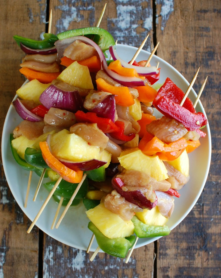 Hawaiian Chicken Kebobs are a festive, colorful meal that is perfect for your next backyard party. Juicy chicken breast is marinated in a Hawaiian flavored marinade and paired with bell peppers, red onion and juicy pineapple. These are easy and a crowd pleaser!