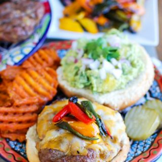 This Southwestern Hamburger with Sweet Guacamole is sure to be a hit at your next backyard party this summer. Southwestern flavors are added to hamburgers and paired with a sweet guacamole of avocados and pineapple. These are a true crowd pleaser!