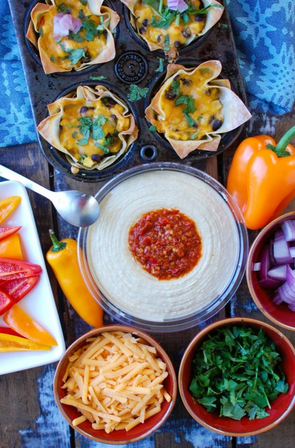 Southwestern Hummus Baked Wonton Cups are a fun finger food mixing spicy hummus, black beans, corn and cheese and baked into a wonton cup until crispy and warm. These are packed with flavor and work great as a snack or party food!
