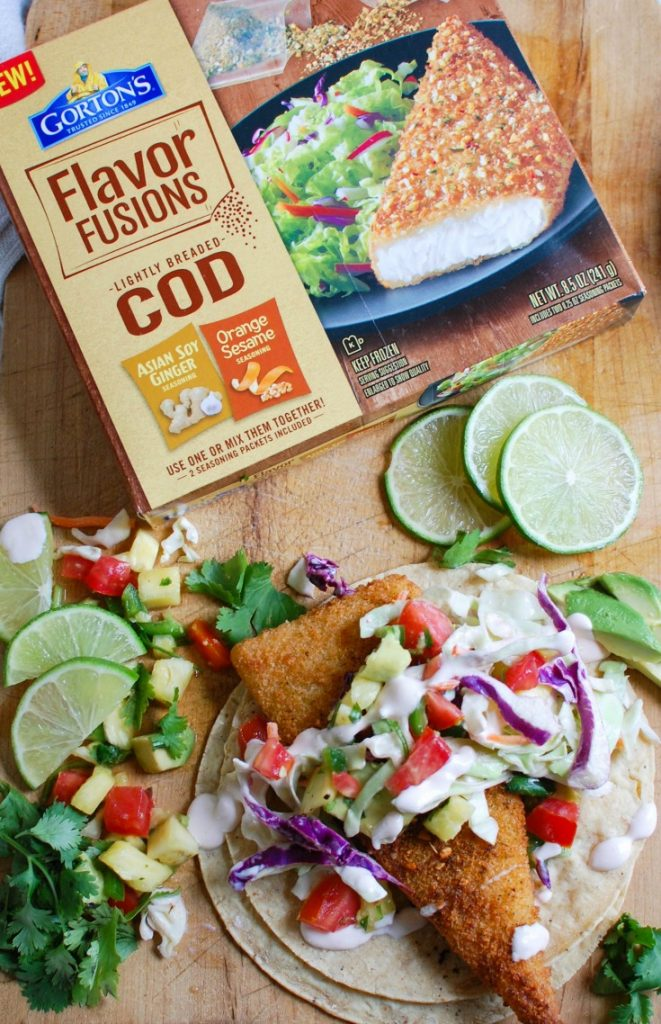 Easy Fish Tacos with Spicy Pineapple Salsa is a quick and easy meal that doesn't lack flavor! These are the perfect way to mix up taco night with baked breaded cod tacos topped with a spicy pineapple salsa and a spicy slaw.